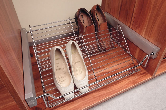 The SHOE SHELF can hold a minimum of four pairs of shoes. It can be pulled out entirely, which provides access to all shoes. Well thought out and developed design and production.