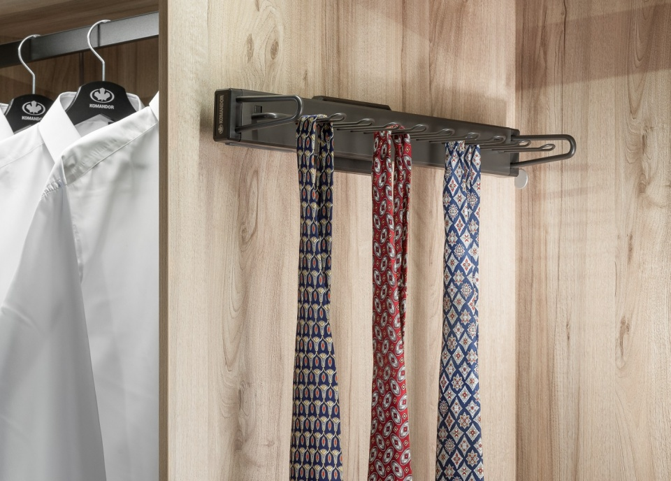 Tie rack 170x445x85 mm Mocca The product allows for a convenient and orderly way to store ties, can accommodate up to 9 pieces. Tie rack possess a soft-close mechanism what makes its work smooth and quiet.