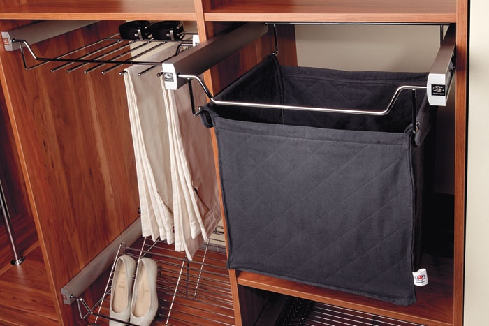 The BASKET WITH LAUNDRY BAG or clothes for laundry or ironing.